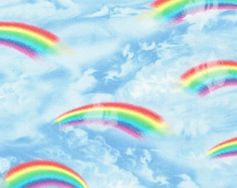 Rainbows and Clouds on blue Cotton Woven by Timeless Treasures