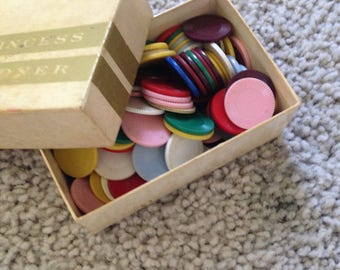A Large Assortment of Grooved Plastic Discs in a Box