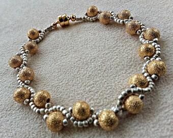 handmade gold and silver serpentine bracelet