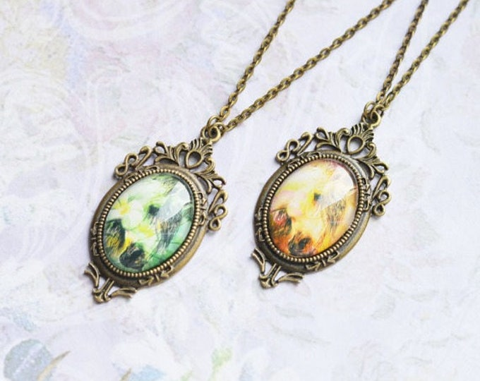 ART Oval pendant metal brass with the image of horses under glass