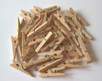 A Pack Of 20 Mini Wooden Pegs
