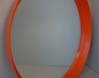 Vintage orange space age mirror 1970s vinyl plastic lightweight retro mid-century modern cute pop-art funky