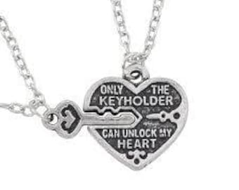 lovely pendant neckalaces 2 peice set, only the keyholder can unlock my heart, also 2 peice set pendants partners in crime neckalaces