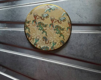 Vogue compact & mirror gold coloured engraved back signed dragon pixie elf phoenix Ganities made in England vintage powder puff Mothers day