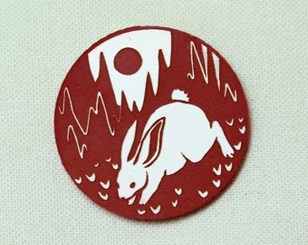 Rabbit in Landscape Pin, red and white, laser cut acrylic