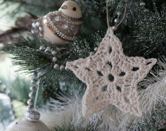 Pack of five crochet Christmas star ornaments in cream - large