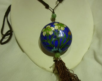 A1 Enameled Pendant on a Braided Cloth Chain.