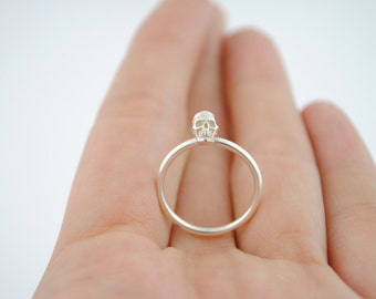Silver ring with mini-skull
