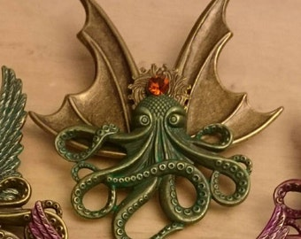 Octopunx Brass Color with Glow in the Dark Patina Finish Steampunk Brooch Cthulu Bat-wing Flying Octopus Creature