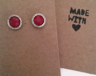 Red and silver stud earrings