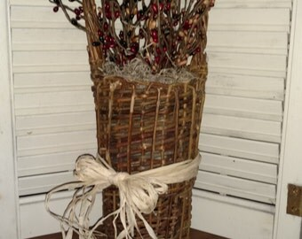 Primitive basket with pip berries
