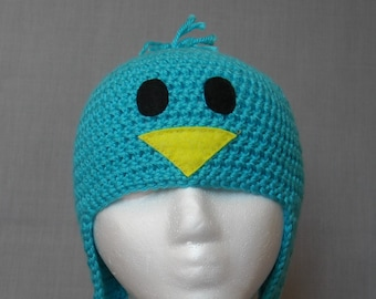 crocheted light blue bird winter hat with earflaps and braided tassels
