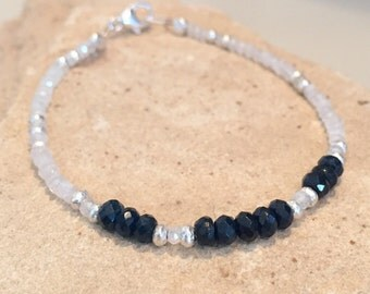 Moonstone bracelet with blue tourmaline rondelle beads, Hill Tribe silver rondelle and triangle beads and a sterling silver trigger clasp