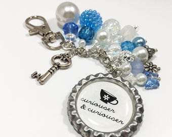 Alice Purse Charm Keychain / Disney Alice in Wonderland Movie Quote Curiouser / Blue White Key Teacup Bottlecap Pendant Beaded Jewelry