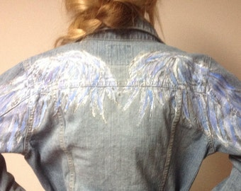 Old Navy Sz L girls Jean jacket,angel wings handpainted across back shoulders in blues,lavender,white and silver outlining! Delicate design!