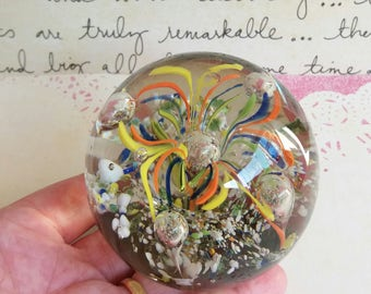 Vintage Glass Paperweight Yellow Orange and Blue with dimple in the top - central controlled bubble