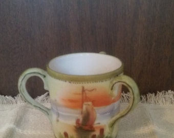 Hand painted porcelain cup.