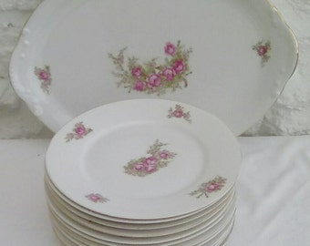 French vintage Limoges porcelain.  Tea  or dessert plates and serving plate. Pink rose design.