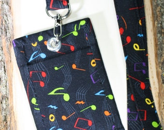 Made to order. Fabric Lanyard & Matching ID Badge Holder. Great gift for music lover or teacher.  Bright colored Music Notes.