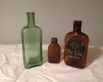 Three Antique Bottles - Brown Glass and Lime Colored Glass