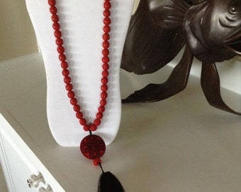 "Beautiful 34"" Red Chinese Cinnabar Necklace With 3"" Black Silk Tassel."