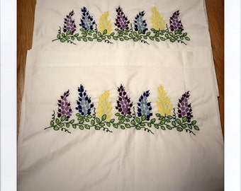 Set of two hand embroidered lilac pillowcases