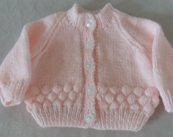 Hand knitted new born cardigans