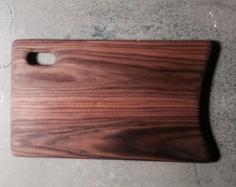"Beautiful Black Walnut cutting board that easy on the hands and the eyes!!!!     11"" x 19 and completey hand made."