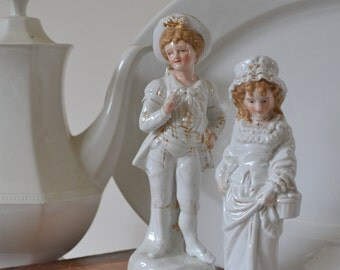 Antique Victorian Boy and Girl figurine couple in white
