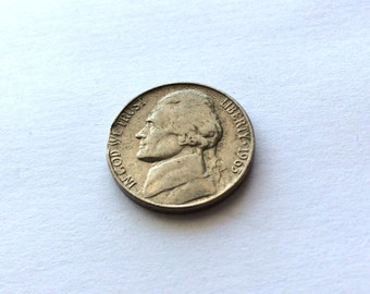 Coin five cents 1963 Jefferson with stamping defect