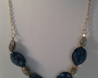 Dark blue with gold speckled stone necklace
