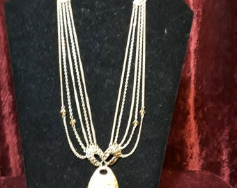 Multi strand gold and crystal necklace