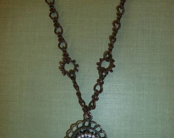 Steampunk cameo necklace with gears