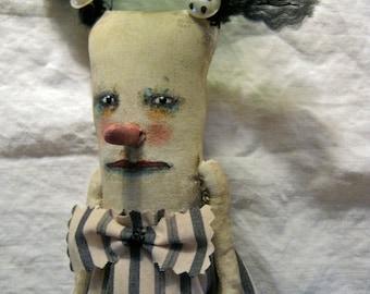 a weird art doll in stripe dress , sandy mastroni, telling secrets weird doll,bizarre ,spooky odd doll