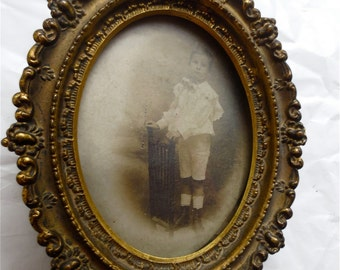 Antique Brass Oval Photo Frame  Easeled Back Brass Repoussed Details with Original Small Boy Photo Portrait