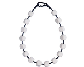 Cream and black necklace, architectural jewelry, designed by Frank Ideas