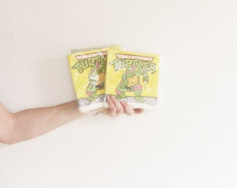 two pack teenage mutant ninja turtle napkins . 1989 pizza party time, dudes . set of 2 .sale s a l e