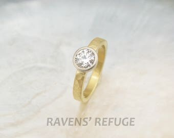 organic eco engagement ring -- hammered 18k gold band with low profile bezel-set diamond