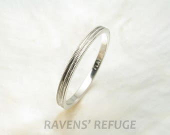 delicate 1.5mm platinum wedding ring with milgrain