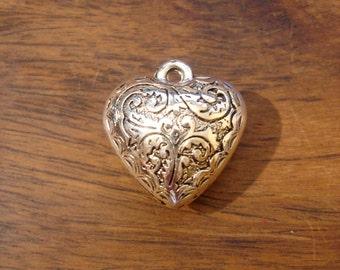 Small ornate  heart hollow cushion pendant