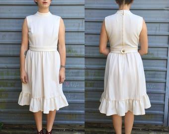1960s handmade ivory dress w/ large ruffle hem & belt