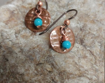 Copper circles with turquoise magnesite dangle beads