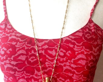 Vintage Gucci golden perfume bottle necklace with logo mark on top. Gorgeous rare masterpiece from 80's.