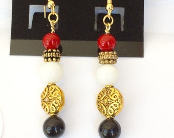 red, white, and black earrings