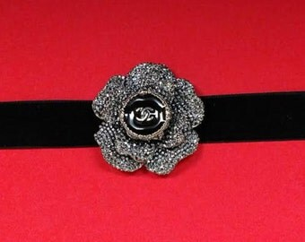 Flower and velvet choker necklace featuring authentic designer, black enamel and silver, iconic button. Adjustable.