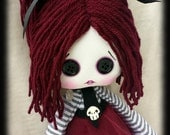 Creepy cute doll Opaline handmade zombie goth cloth doll with black button eyes and skulls. Goth rag doll. Goth cloth doll