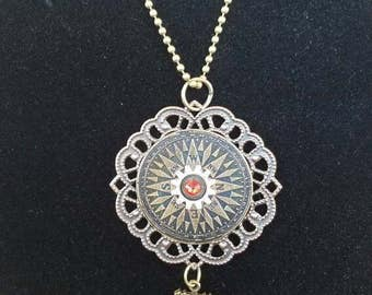 Steampunk inspired compass gear anchor filigree necklace