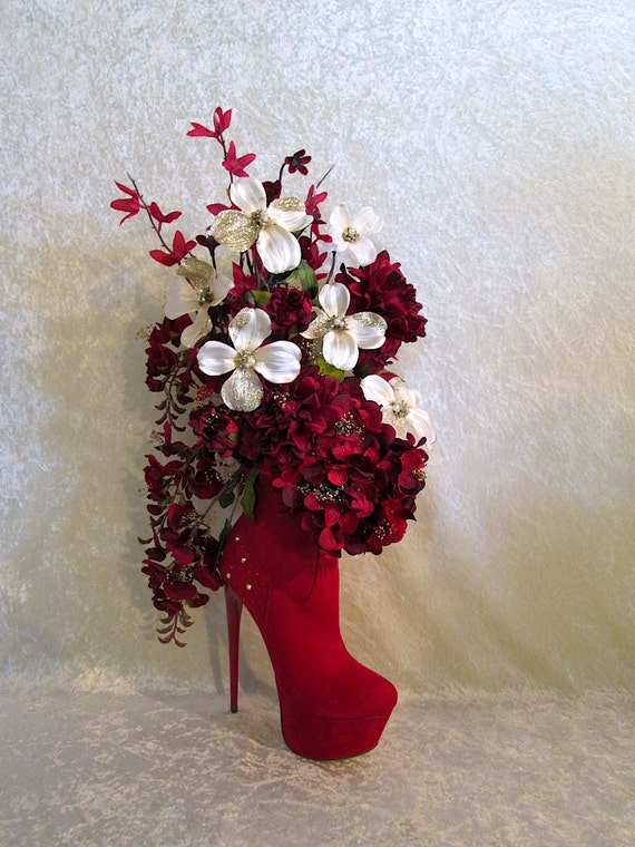 Silk flower arrangement in a high heel shoe floral