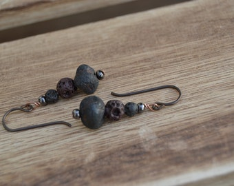 Organic lava dangle earrings on niobium ear wires.