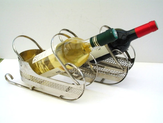 A Pair Of Wine Bottle Holders In Sleigh Form